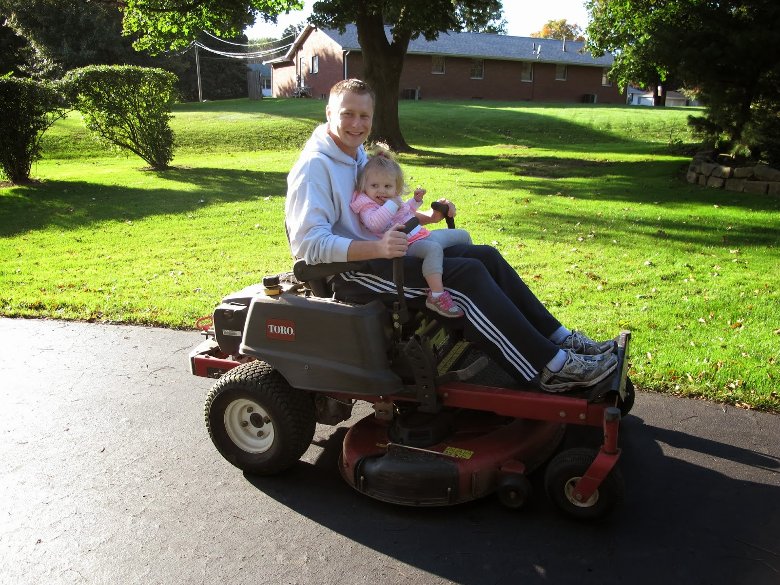 Daddy & Stella on the Mower