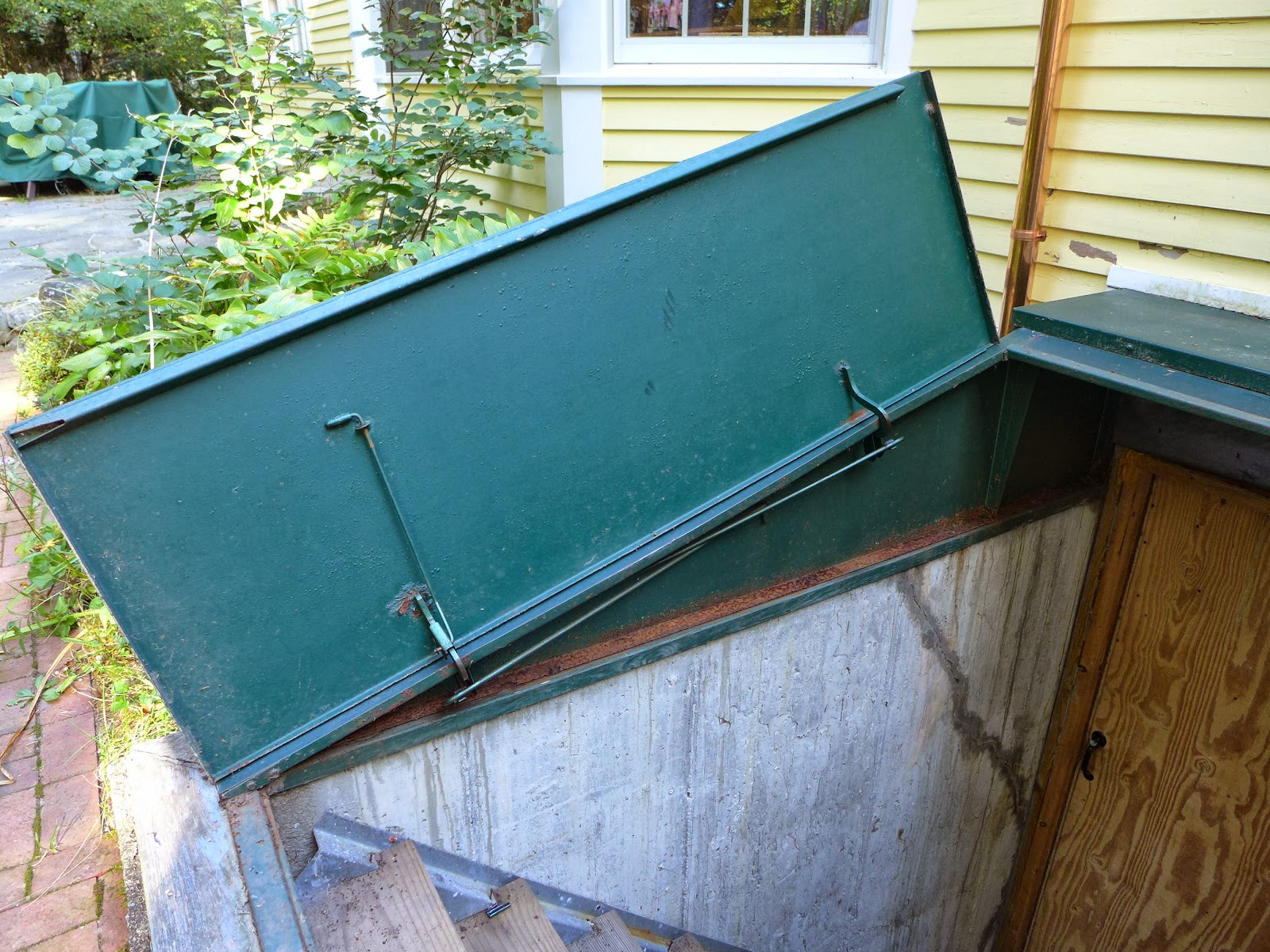 A less than ideal installation in addition to a roof valley pouring gobs of rainwater on it had rusted the flanges out and it was leaking profusely almost ... & Nails and Sawdust: Rebuilding an old Bilco basement bulkhead door