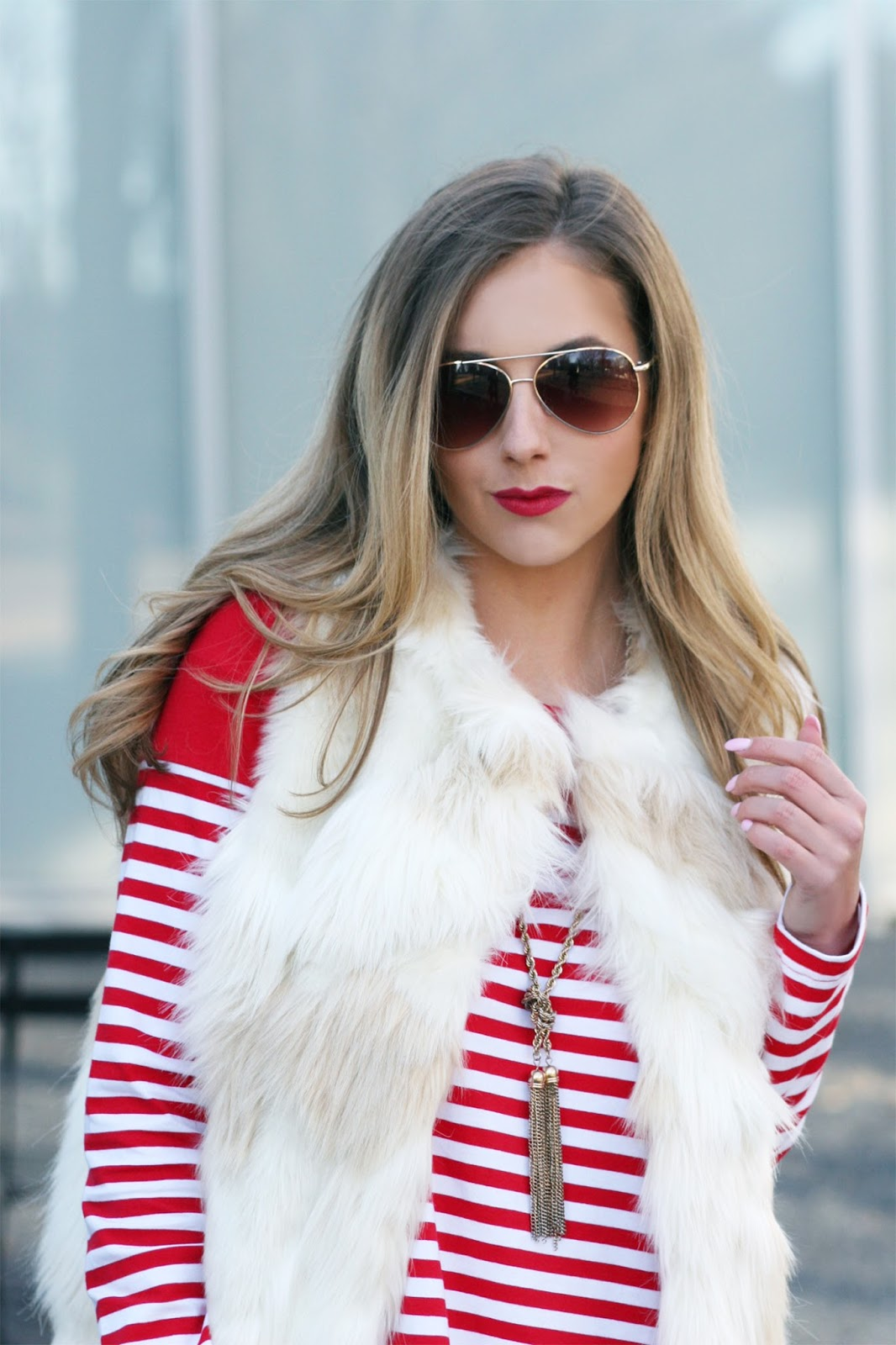 what-to-wear-for-valentines-day-fur-vest-stripe-dress-street-style