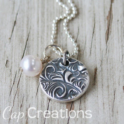 http://www.capscreations.com/item_999119/Compass-Wax-Seal-Pendant.htm