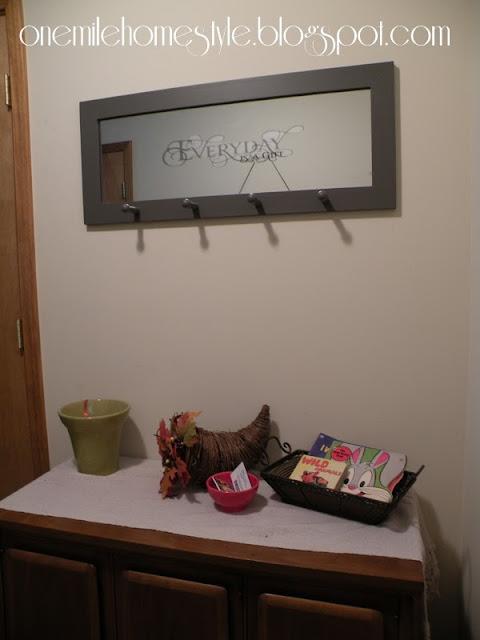 Dark gray mirror in entryway