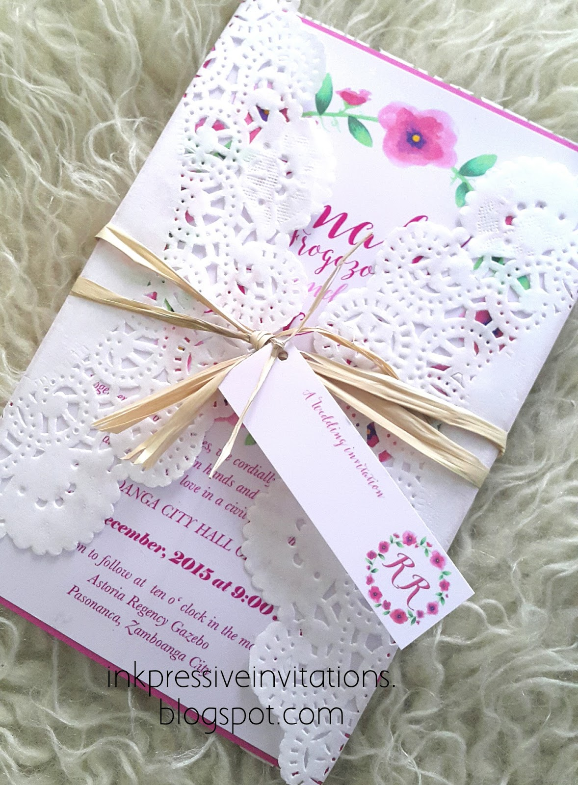 doily wrapped wedding invitation pink watercolor wreath