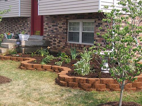 Brick driveway image brick edging for your flower beds - Stone edging for garden beds ...