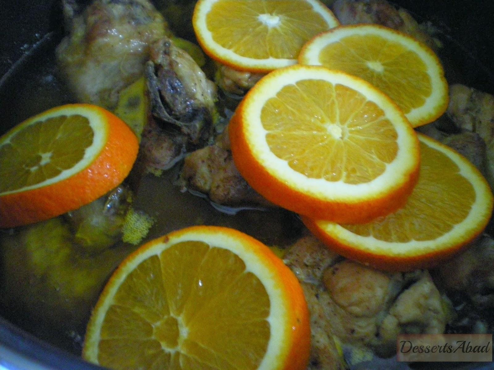 Pollo salteado con  almendras y naranjas