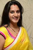 Surekha Vani Yellow Saree Hot photos at Yevadu movie Press Meet16