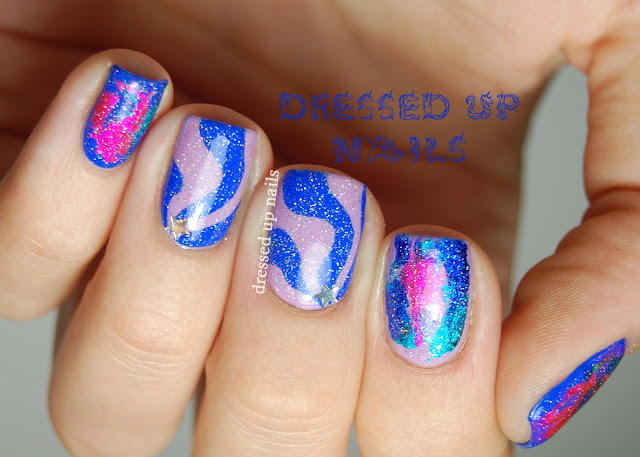 Dressed Up Nails - nail foils and freehand swirls with star glitter nail art