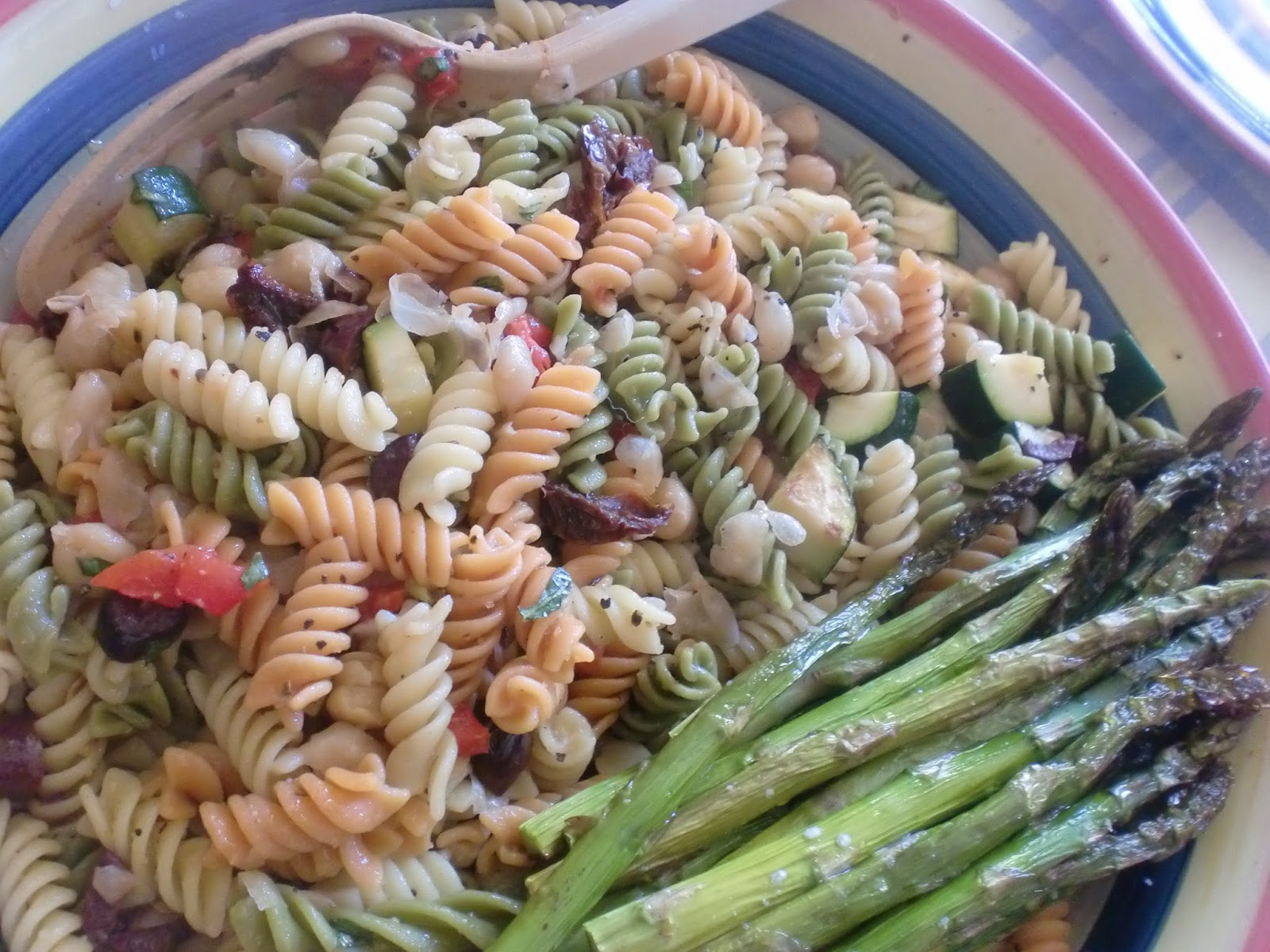 Rotini pasta with tomato, olives, red onion, garlic, roasted bell ...