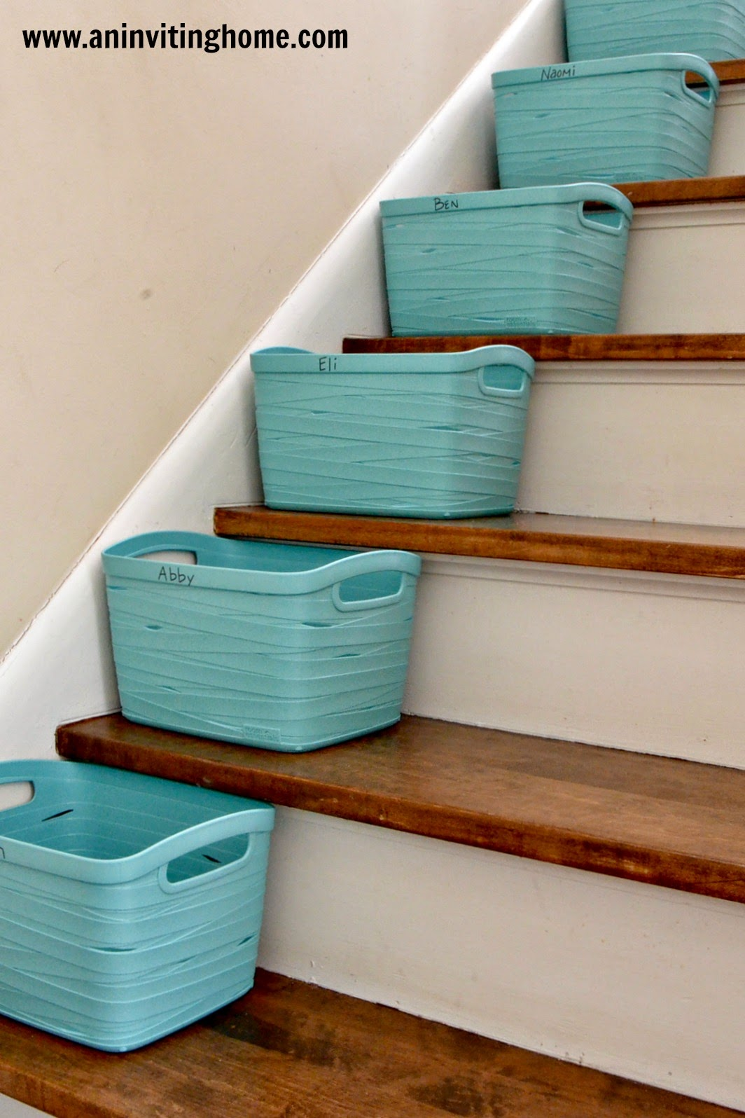 bins on your stairs to help organize