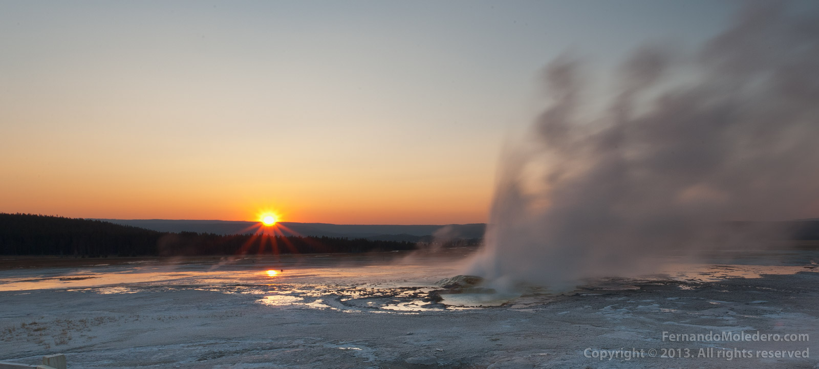 Geyser at sunset Yellowstone National Park Lower Mid Basin Wyoming US