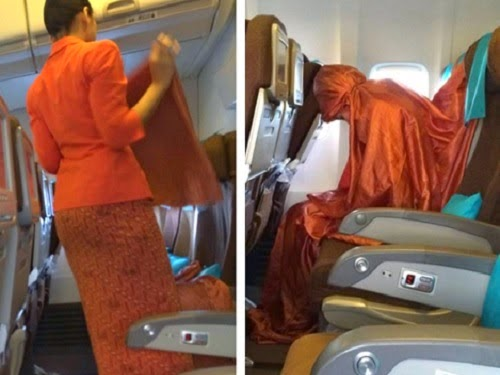Heboh, Foto Pramugari Garuda Shalat Dalam Pesawat - BERITA TERKINI