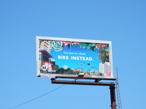 Bike instead Metro billboard