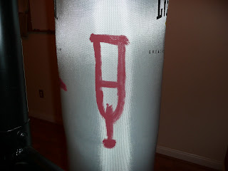 Drawings on an 80-pound heavy punching bag
