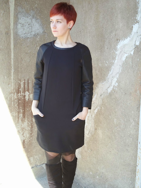 Black leather sleeves dress, suede boots, patterned pantyhose