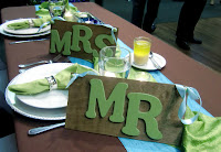 Mr. and Mrs. signs to go on bride and groom chairs  Photo by Patricia Stimac