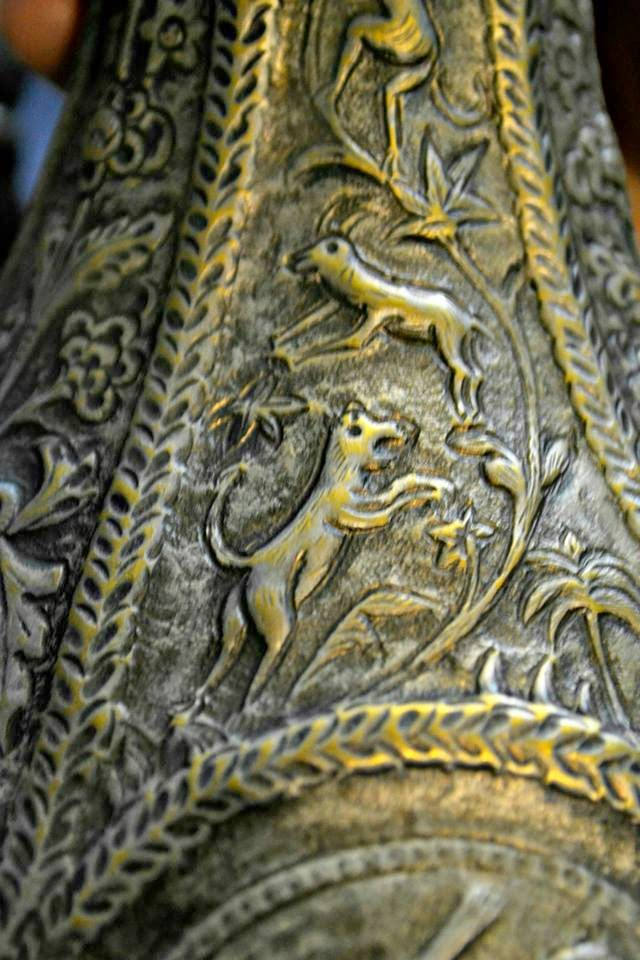 afghani jug with antique carvings
