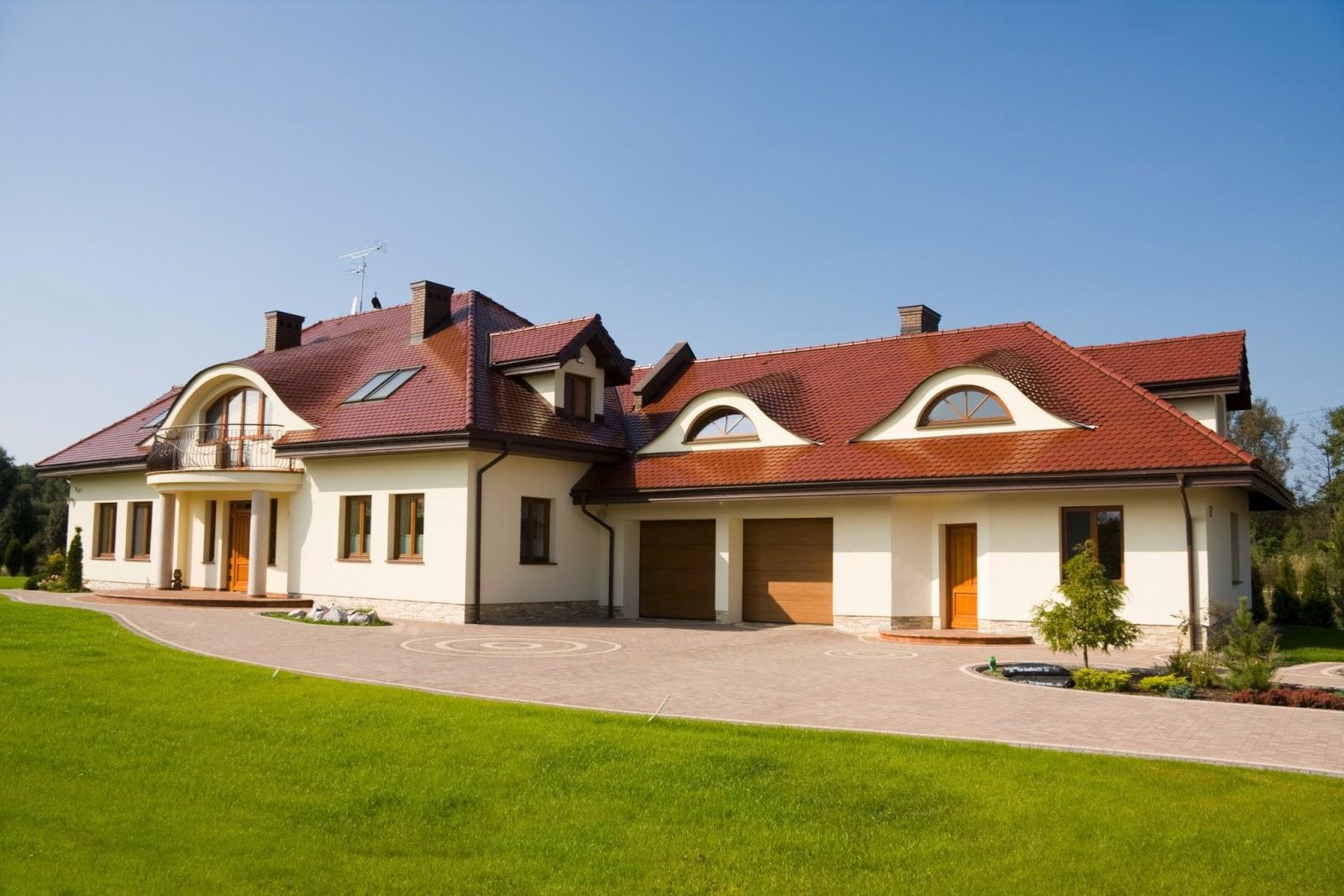 Banco de im genes 12 fotos de casas y residencias for Fotos de casas modernas con tejas