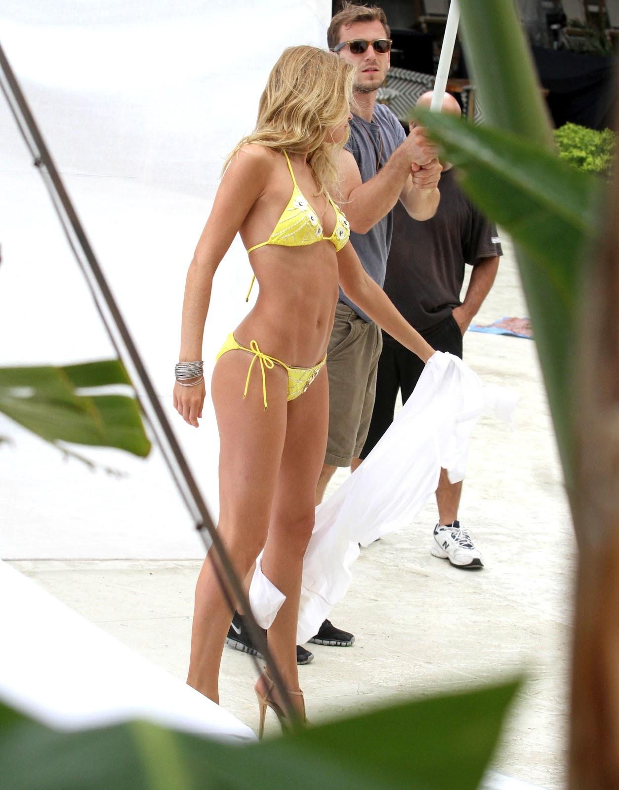 http://4.bp.blogspot.com/-mqIs9e2qkf8/UGBdhpFudQI/AAAAAAAAO_8/D6jASJtmaac/s1600/Doutzen+Kroes+yellow+Bikini+Photoshoot+in+Miami+Sept+2012+-01.jpg