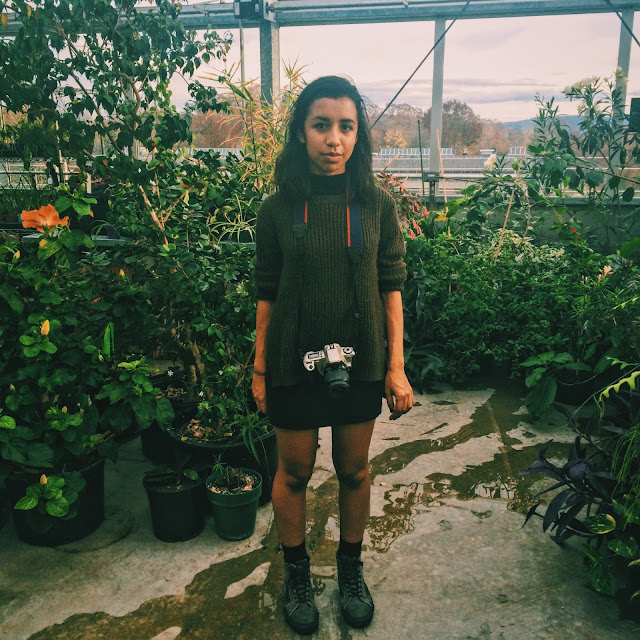 standing in greenhouse