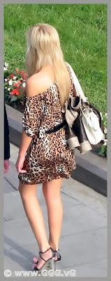 Blonde girl in summer open back dress on the street