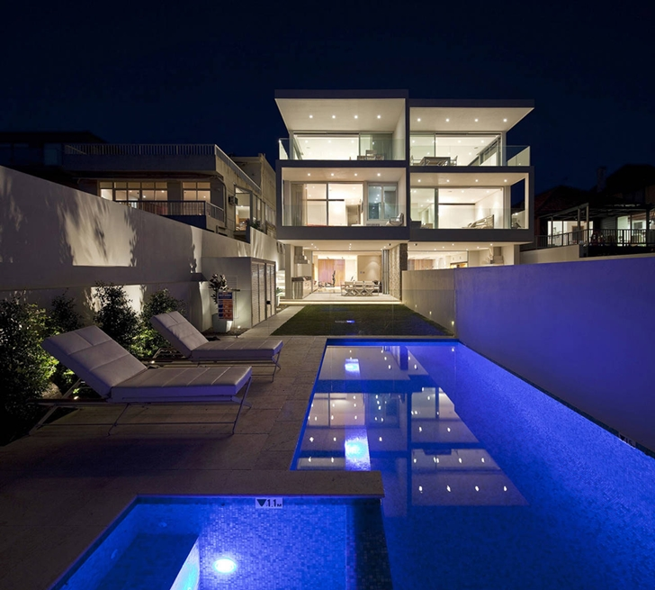 Swimming pool and Portland Street Duplex by MPR Design Group at night
