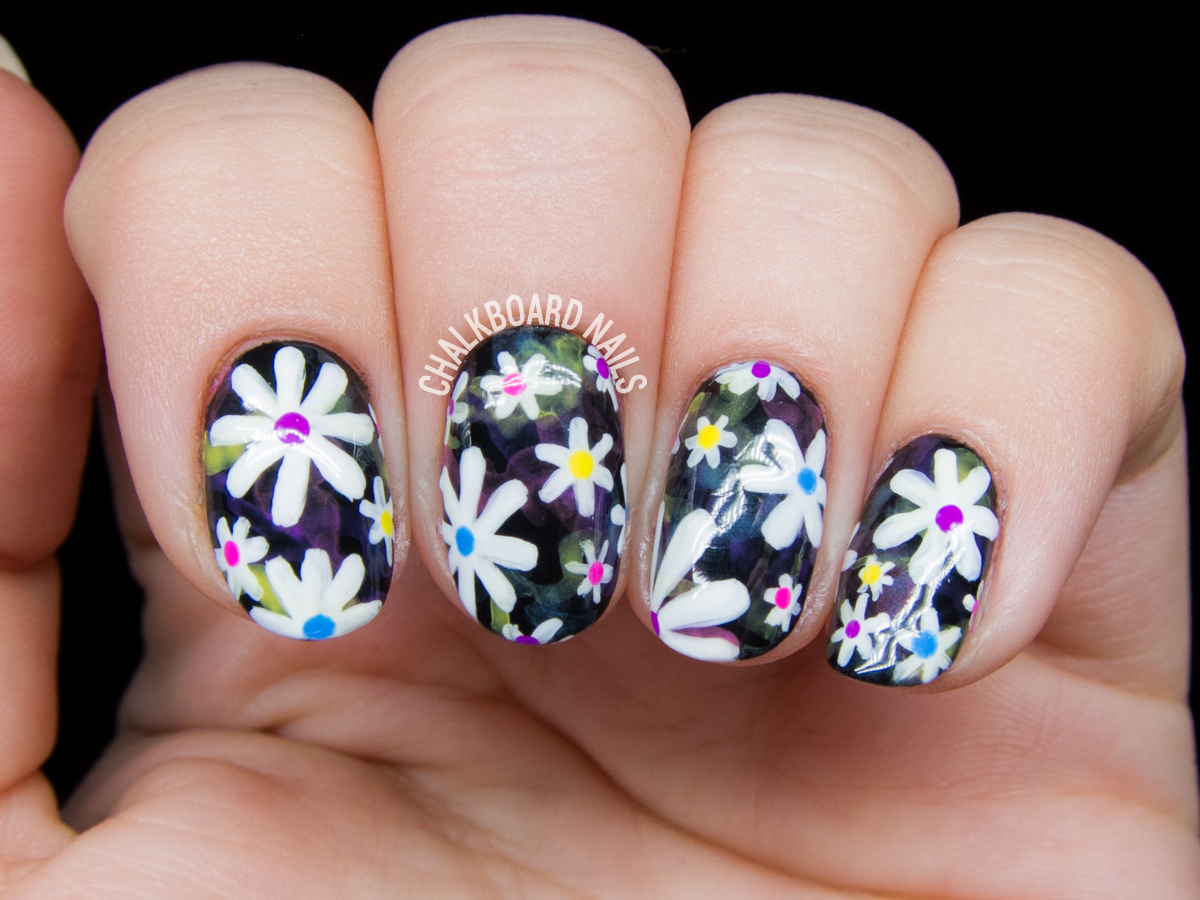 Electric daisy nail art by @chalkboardnails