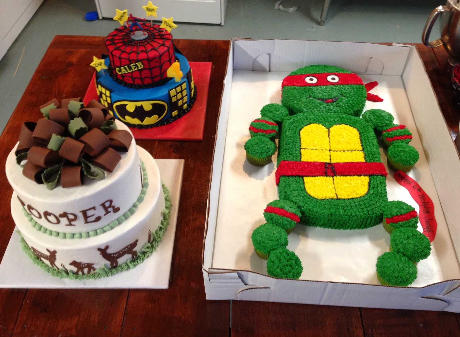 ninja turtle super heroes and deer silhouette baby shower cake