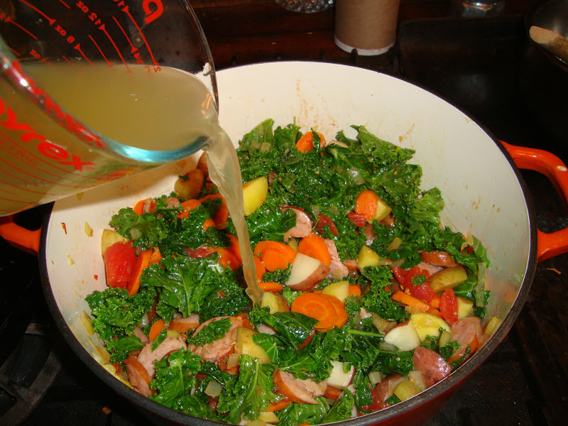 Add cut up tomatoes and their juices, and then chicken stock, and ...