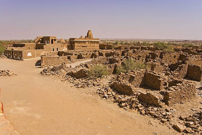 Kuldhara village near Jaisalmer has a very unique history! It is said that the residents of 84 neighboring villages including Kuldhara vacated the villages overnight around 170 years back!! No one is sure where they have gone, but they are believed to have migrated to a place somewhere near Jodhpur. The residents were Paliwal Brahmans — said to be very intelligent, and residing there for about 500 years. So what made them do such an act? Stories say that the ruler of these villages pounded the Paliwals with heavy taxes and treated them very inhumanly; the ruler was unethical and forceful to them. They had no alternative, but to vacate all the 84 villages overnight and just disappear from the vision and reach of the ruler.  When the Paliwals left the villages, they left a curse that nobody can inhabit the villages ever. Residents of Jaisalmer say that there have been some attempts by some families to stay there, but they did not succeed.
