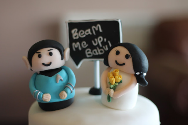 Star Trek themed Wedding cake, bride and groom Star Trek characters with beam me up baby written on a mini chalkboard