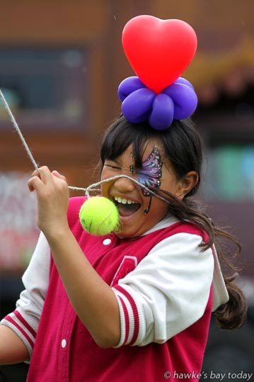Hine-Raumati Kireka, 8, Flaxmere, Hastings, playing swingball at the annual Gypsy Fair in the Havelock North Domain, Havelock North. photograph