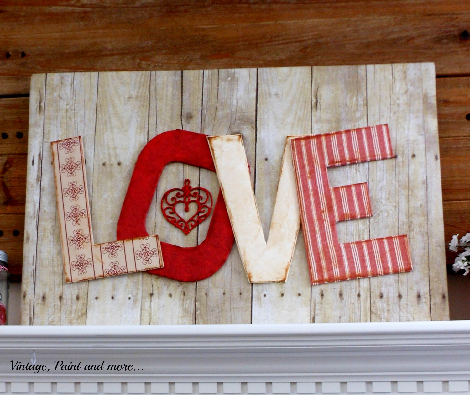Foam board and scrapbook paper used to make a LOVE sign for Valentine.