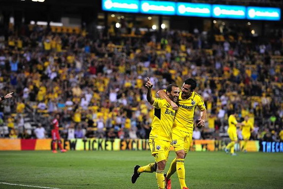 Federico Higuaín celebrates a goal against Toronto FC with Columbus teammate Bernardo Añor