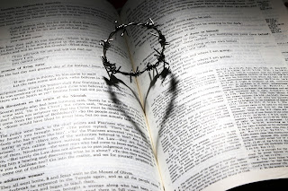 Crown of thorns on open Bible
