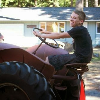 Hunter on his tractor