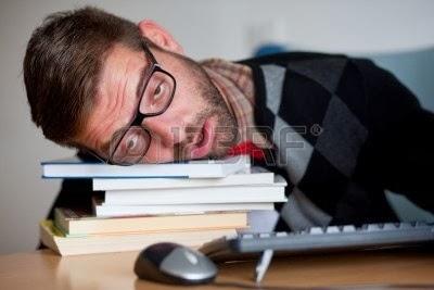 [Image: 9689278-a-tired-nerd-falling-asleep-on-a...-books.jpg]