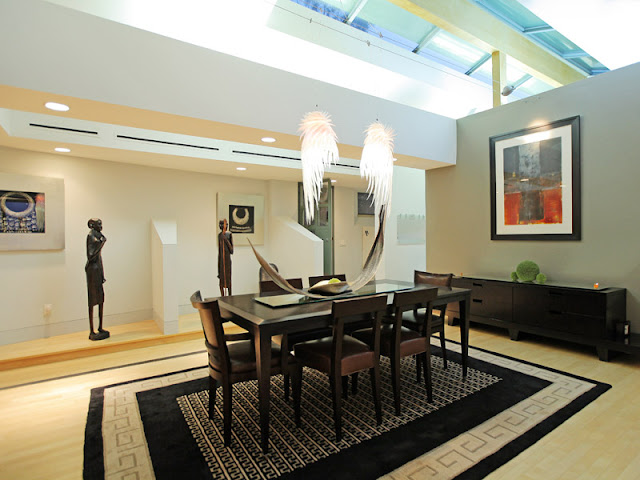 Photo of another dining room with wooden black table and black chairs