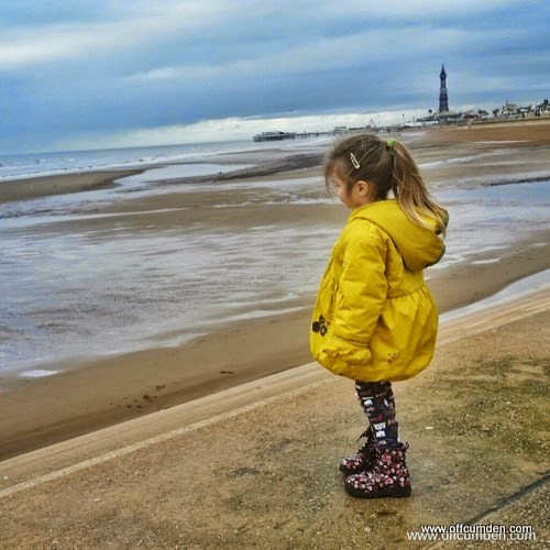 child looking out to sea