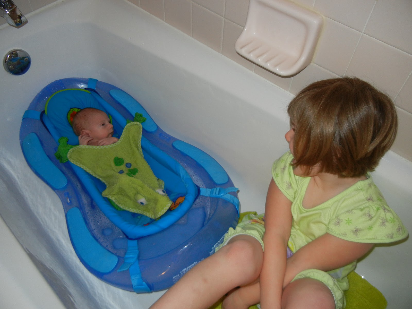 Brooke is finally a big sister!: Bath time with sister\'s help!