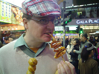 squid on a stick with cuddle fish balls