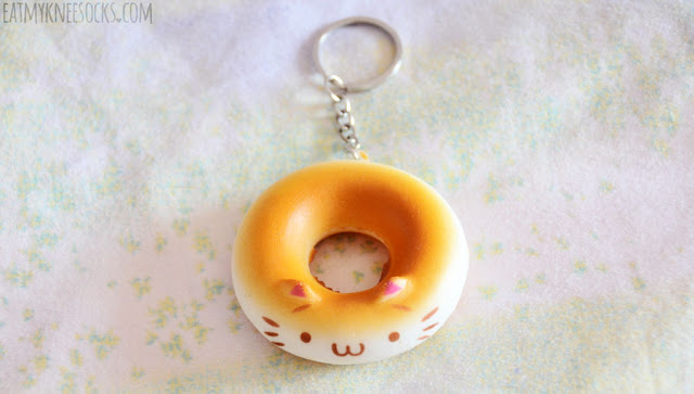 The September 2015 Skoshbox DEKAbox included a squishy cat donut keychain as the mystery accessory, with five different colors.