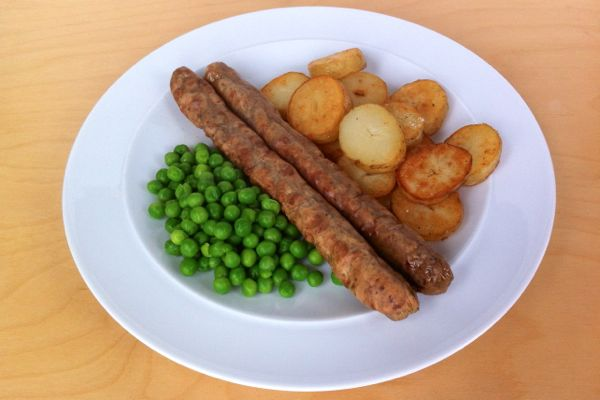 Taifun vegan sausages served with fried potatoes