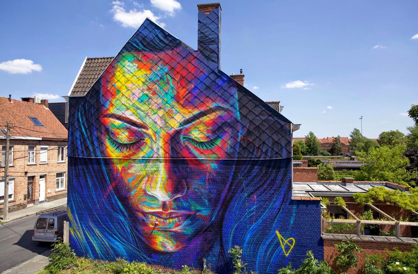 After a quick stop by Aubervilliers in France (covered), David Walker is now in Belgium where he just wrapped up this monster mural on the streets of Roeselare in Belgium.