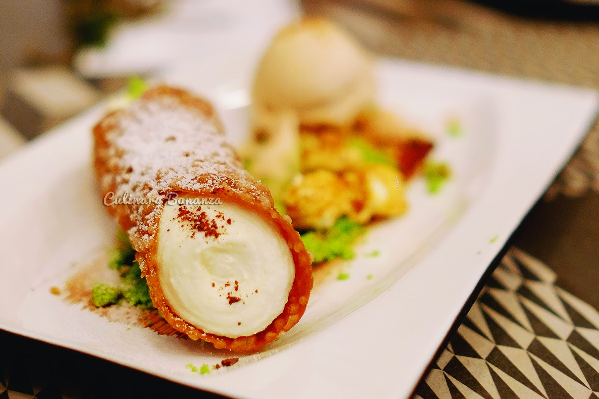 Cannoli Siciliani - ricotta cream, hazelnut gelato, pop corn, pistachio soft cake crumbs (source www.culinarybonanza.com)