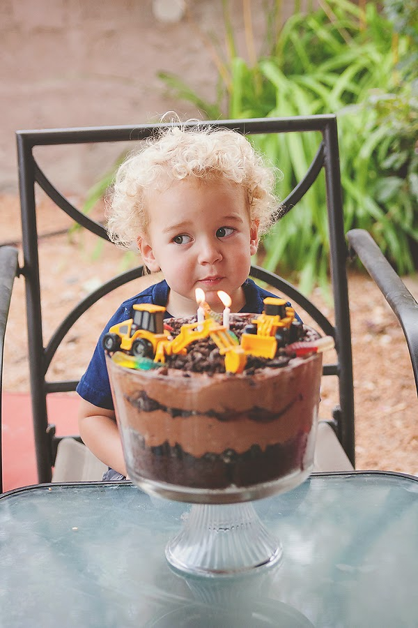 layered dirt cake with trucks two year old birthday