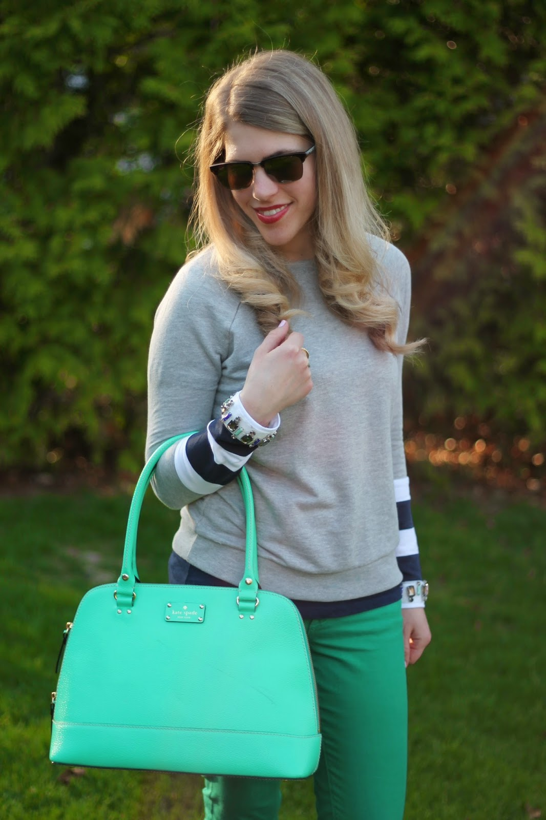 jewel embellished grey sweatshirt, green jeans, striped flats, mint kate spade bag