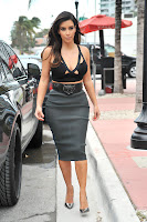 Kim Kardashian looking hot in a cut out top and tight skirt