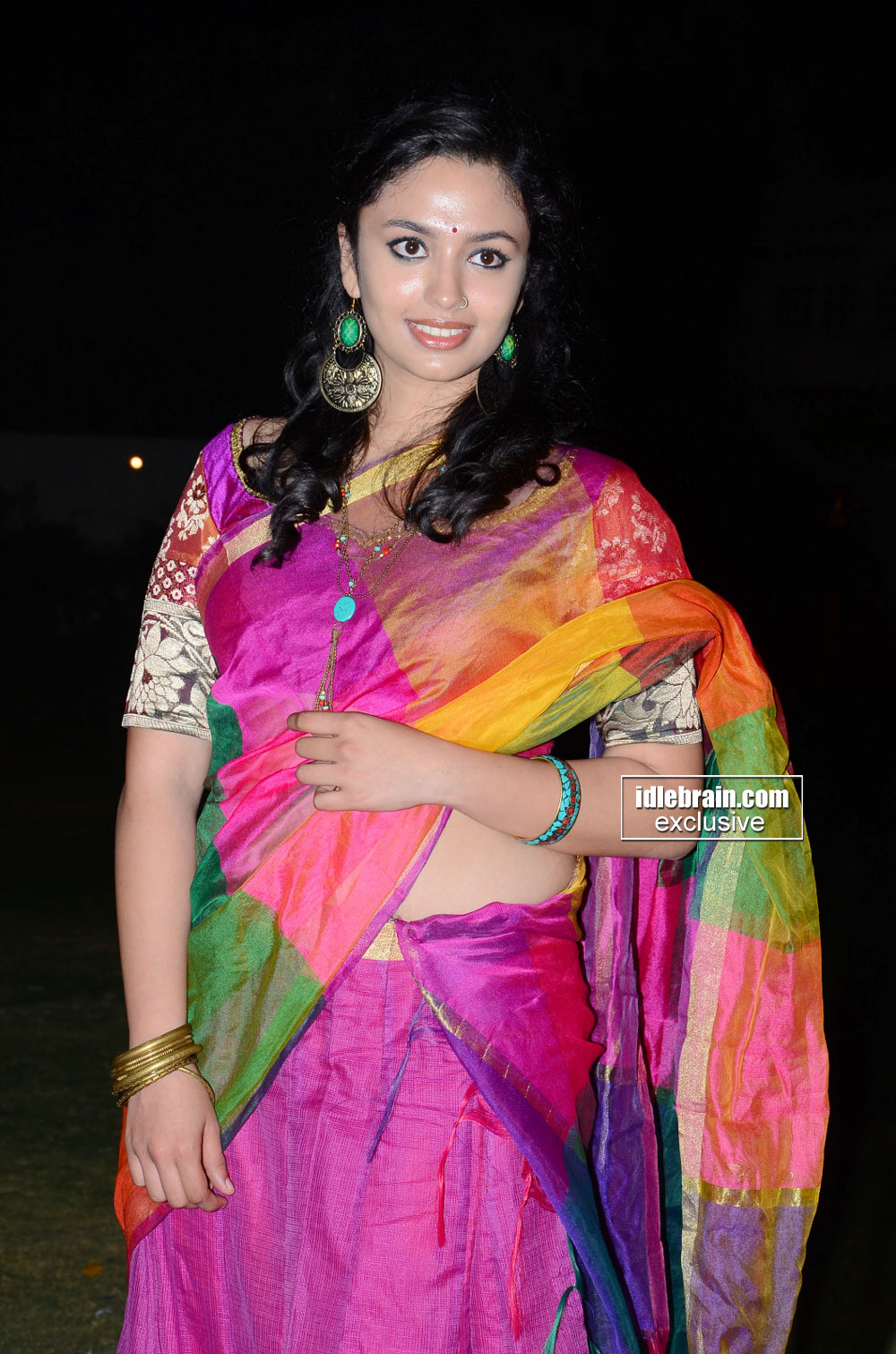 Malavika Nair latest hot navel show photos in saree from Yevade Subramanyam audio launch