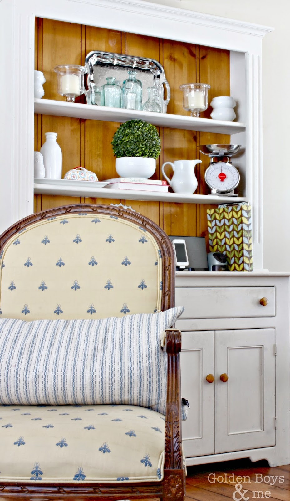 Ethan Allen chair with bee print in front of painted hutch with spring decor-www.goldenboysandme.com