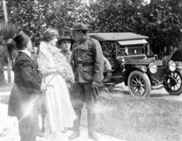 Motion picture scene, 1916. Harry Naughton, Ethel Burton, and unidentified actors. Unable to tell which individual is which.