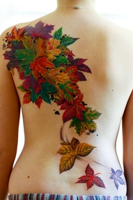 Colorful leaf tattoos on side full body